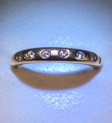 14k YG band with 7 tiny stones