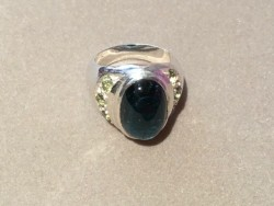 An Indicolite Ring Accented by Demantoid Garnets